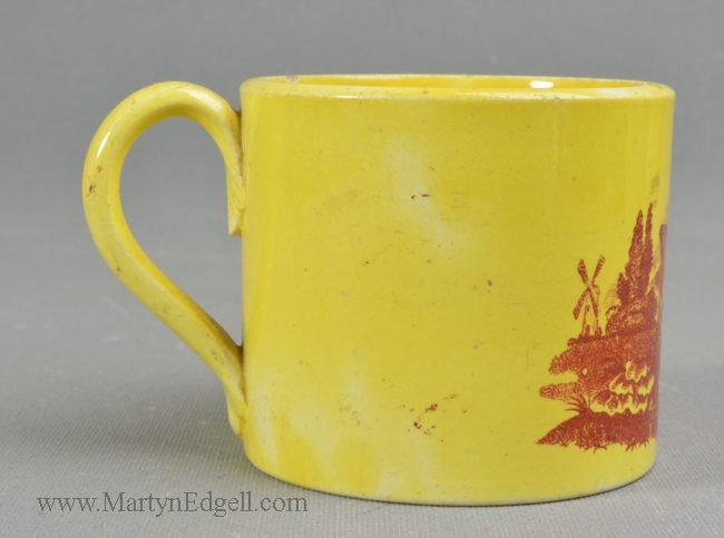 Antique pottery canary child's mug