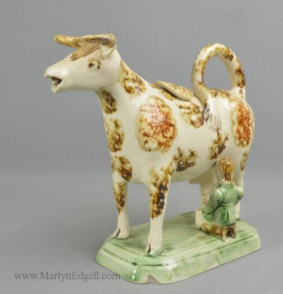 Antique pottery cow