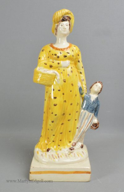 Antique pottery creamware figure