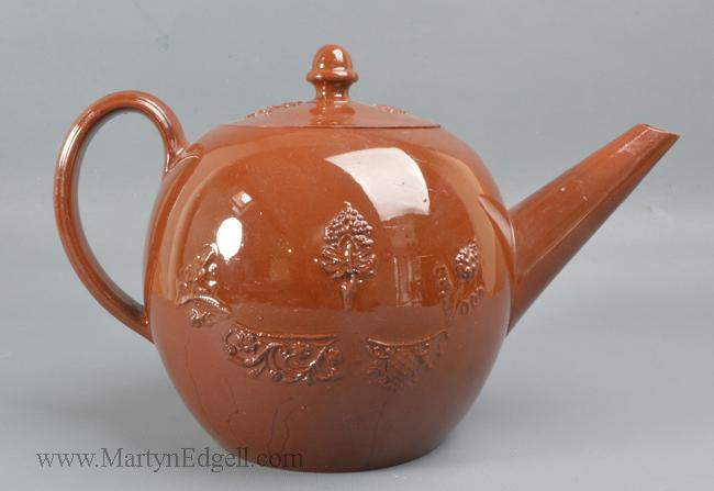 Antique red stoneware teapot
