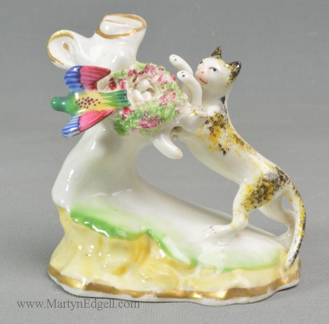 Antique porcelain cat figure