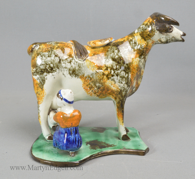 Antique pottery cow creamer