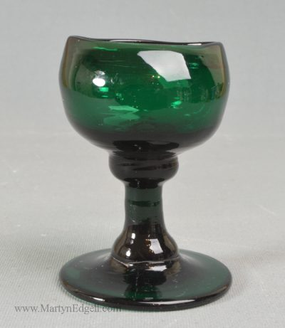 Antique glass blown green eye bath