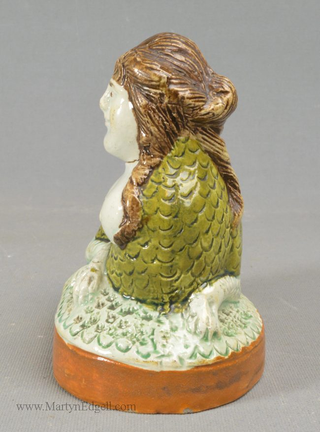 Antique pearlware pottery sphinx