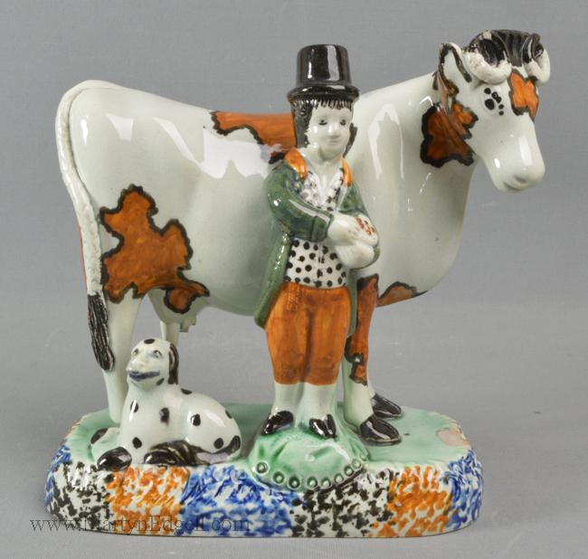 Antique prattware pottery cow group