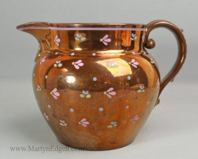 Antique copper lustre jug