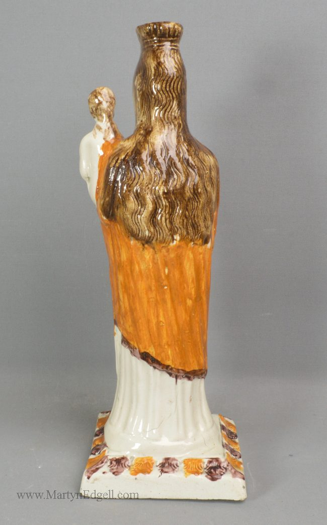 Antique creamware pottery figure