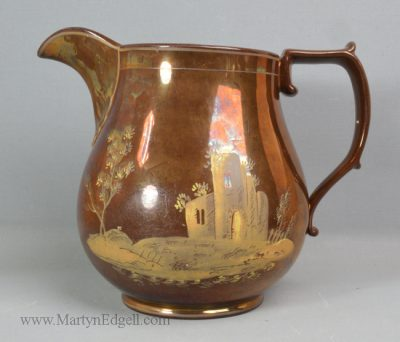 Antique pottery copper lustre jug