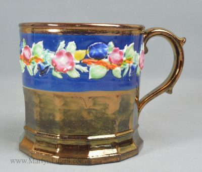 Antique pottery copper lustre mug