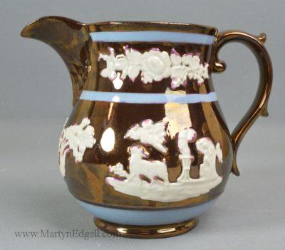 Antique pottery copper lustre jug