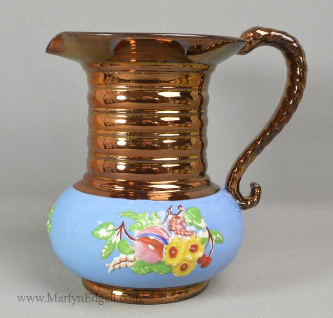 Antique copper lustre jug