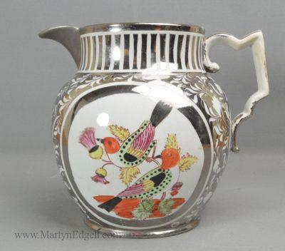 Antique silver lustre pottery jug