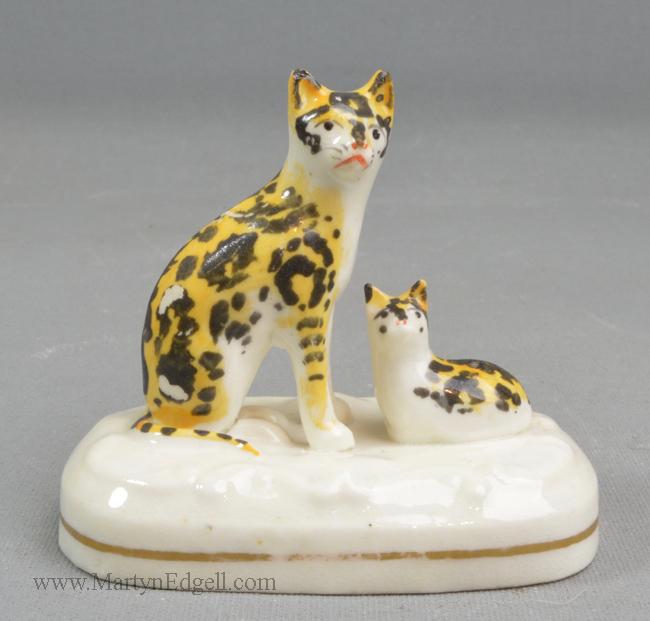 Antique porcelain cats