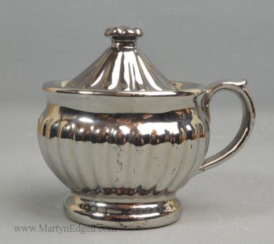 Antique silver lustre pot