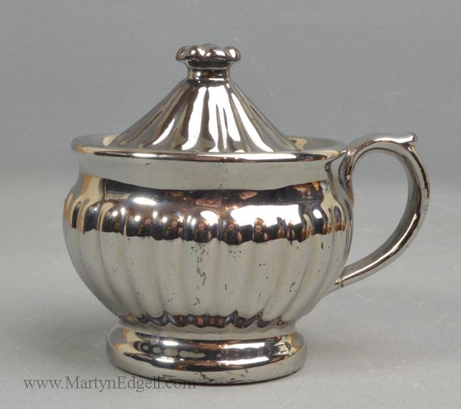 Antique silver lustre pot