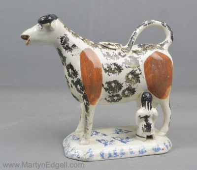 Antique pottery cow creamer