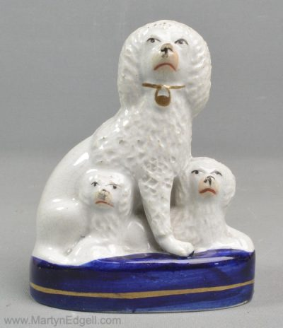 Antique Staffordshire poodles