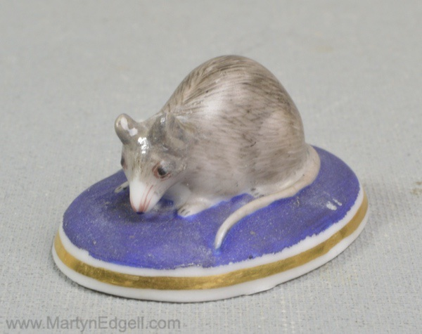 Antique porcelain mouse