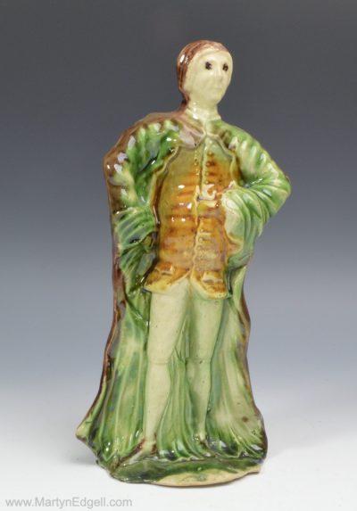 Creamware pottery figure