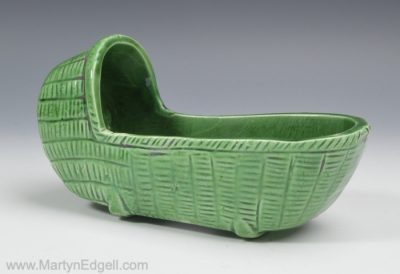 Child's pottery toy cradle