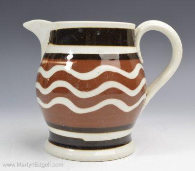 Mochaware pottery jug