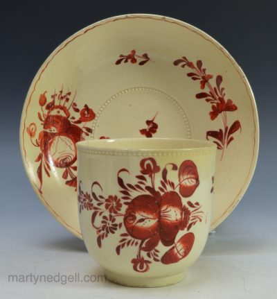 Creamware pottery cup & saucer