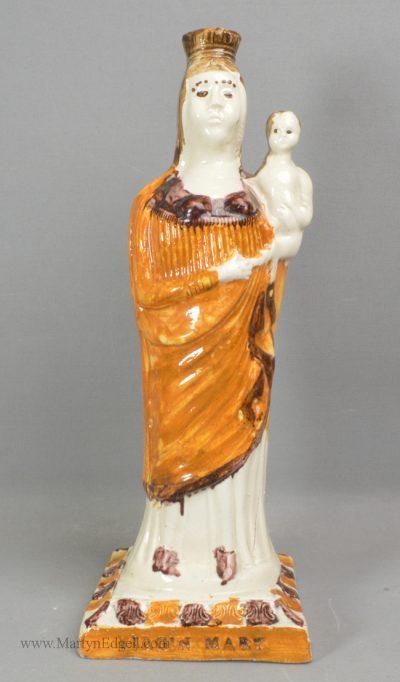 Antique creamware pottery figure