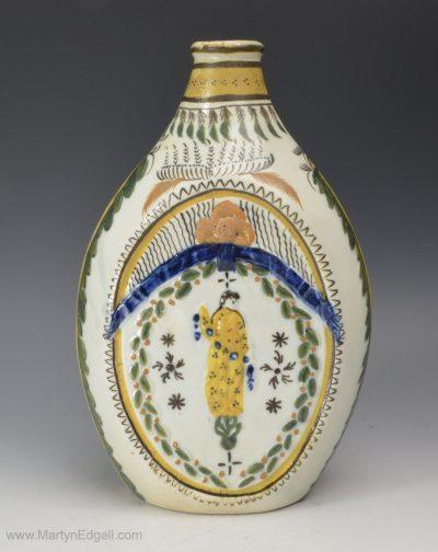 Prattware pottery flask
